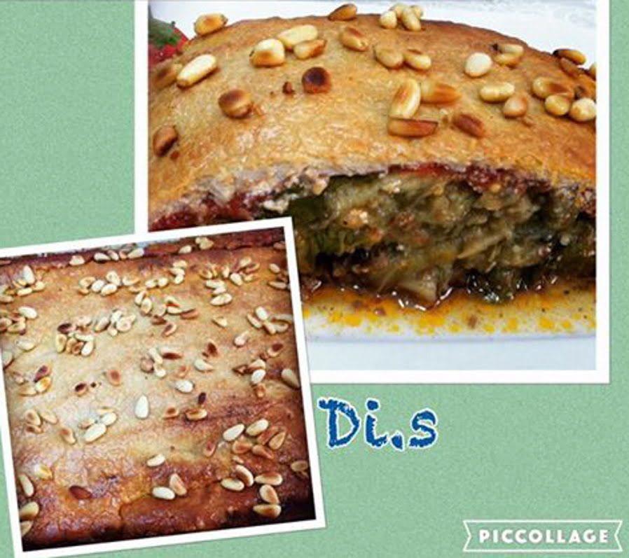 סינייה -שכבות של בשר טחון חציל קלוי ,רוטב עגבניות וטחינה